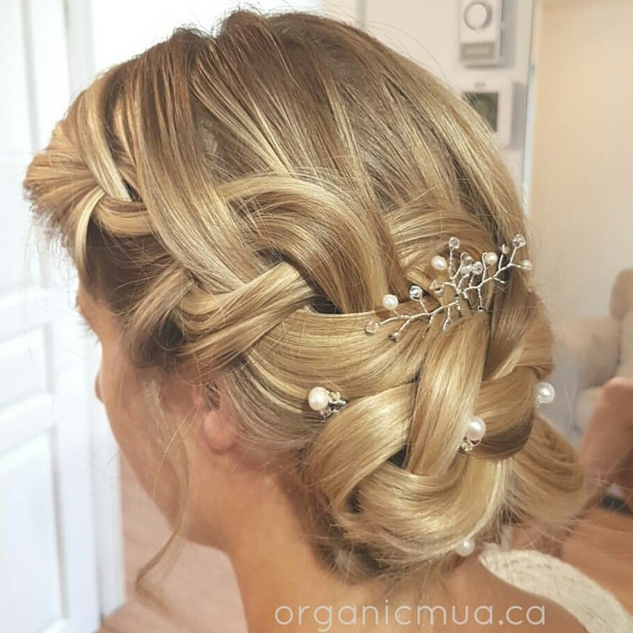 Simple pearl hair pins with detailed crystal hair pins to create this stunning braided updo by Organic Makeup Artistry