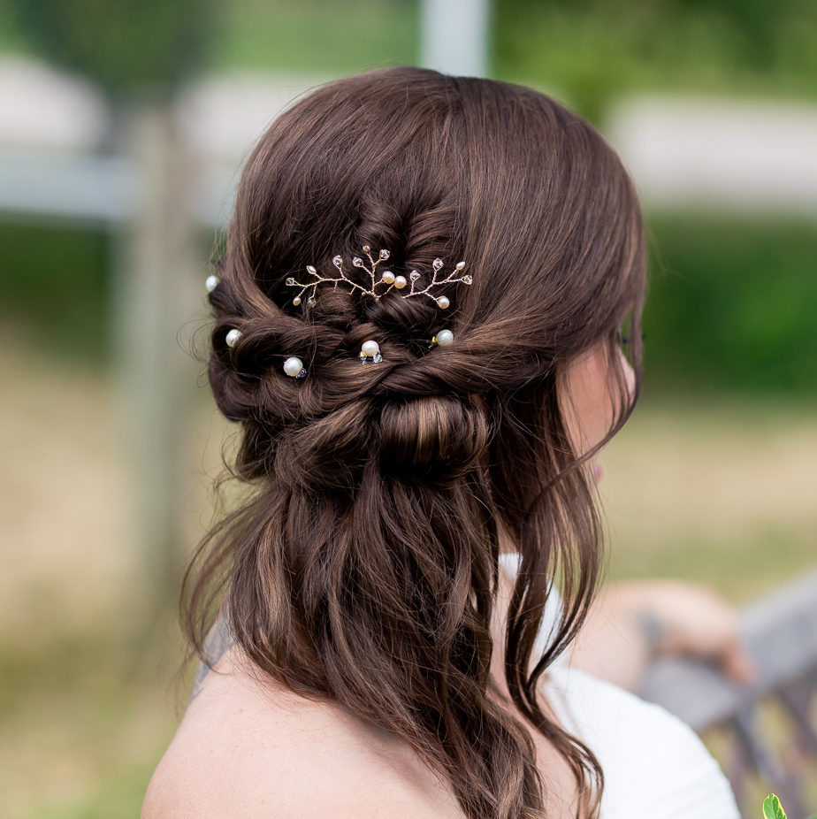 Braided hairstyle with pearl hair pins and rose gold hair pins west coast jewelry